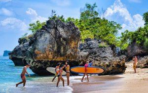 Surfers at Padang Padang Beach