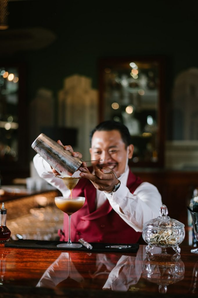 Bartender shaking a cocktail at Aperitif Bali