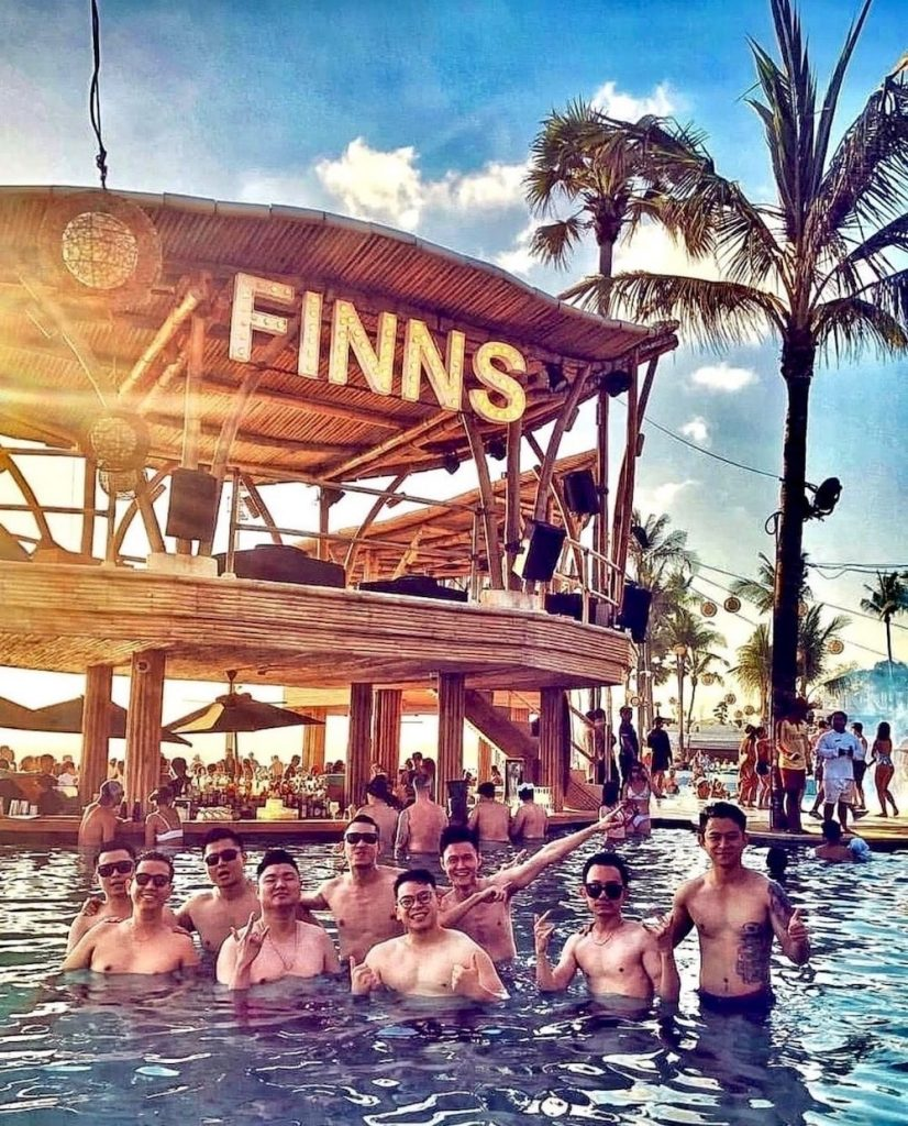 People having fun in the pool of Finns Beach Club