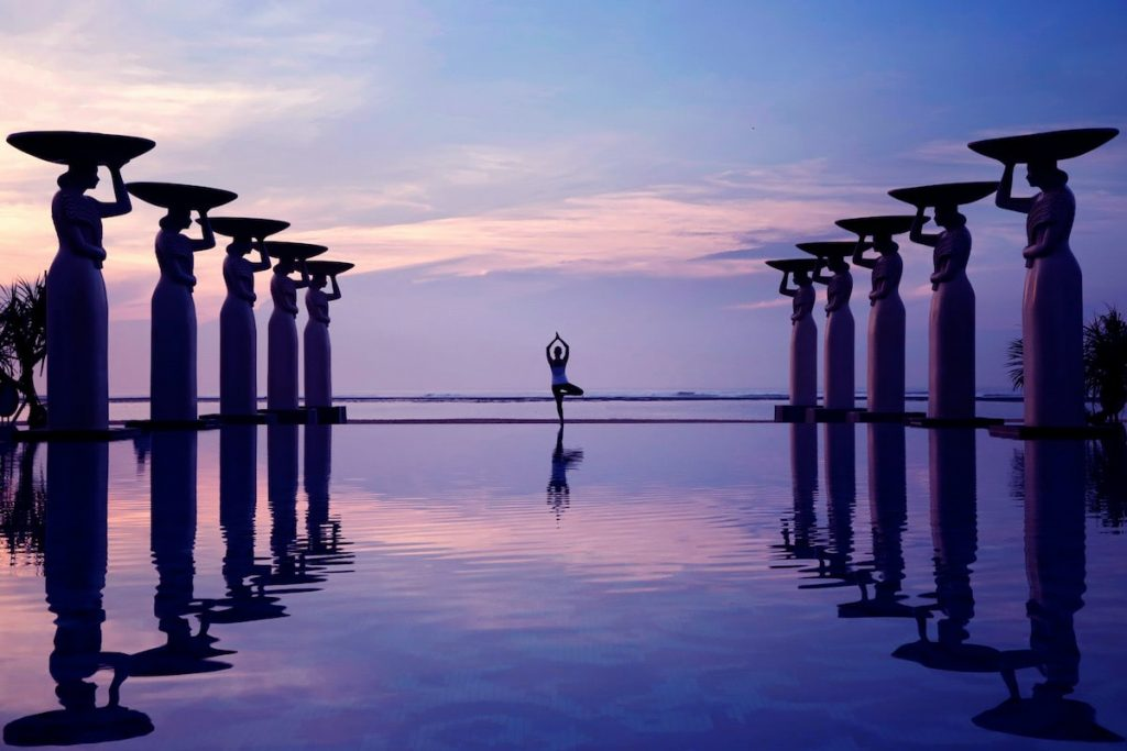 Sunset yoga by the pool - Mulia Bali