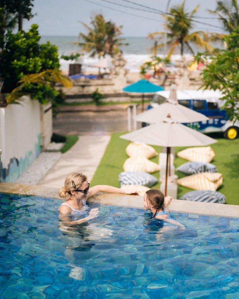 Mother and daughter having fun in the pool at Away Resort Legian