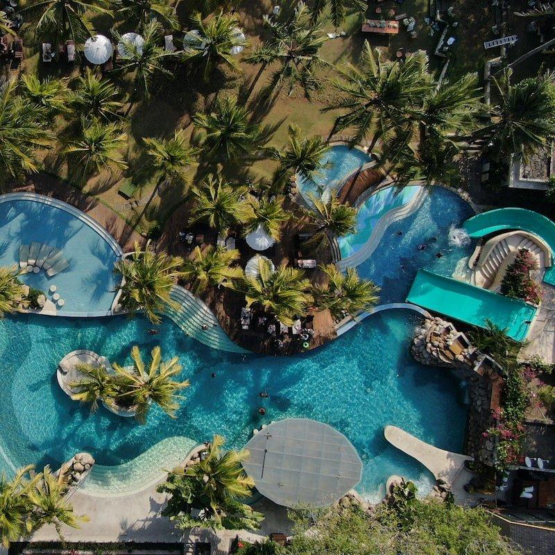 Aerial view of bali mandira resort legian's pools - resort day pass bali by Bali Buddies