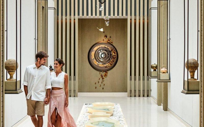 Couple-in-Arkipela-Spa-hallway-2-min-scaled-800x500