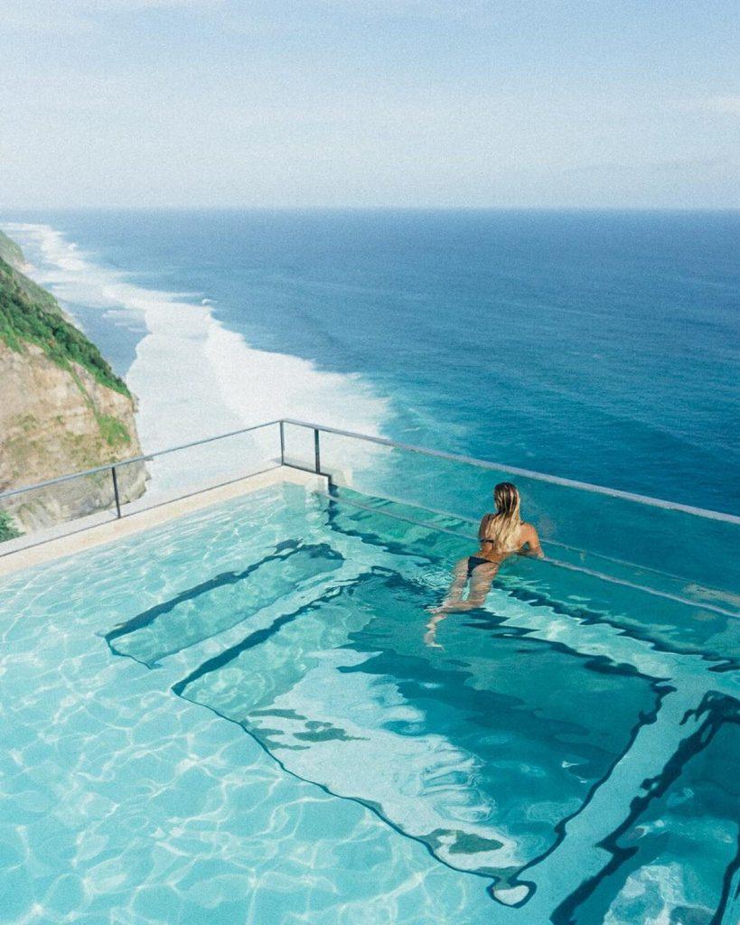 Woman at Oneeighty Bali in Infinity Pool overlooking the ocean