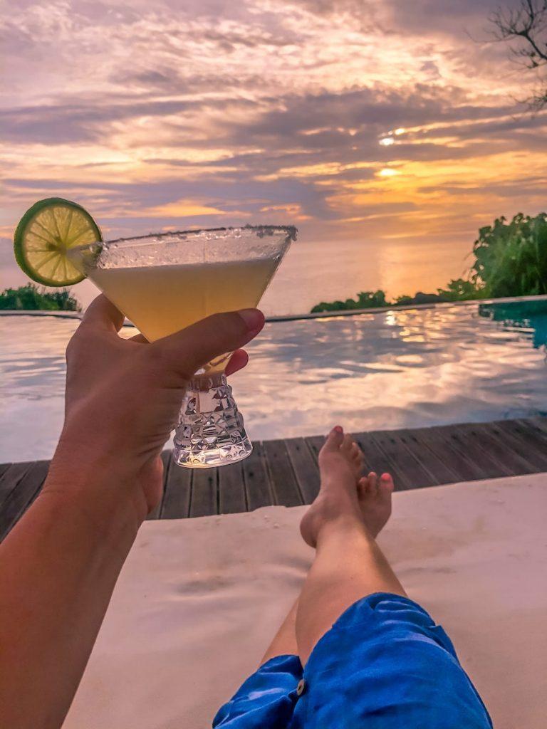 Sunsets and cocktails at the main resort pool at Lelewatu Resort