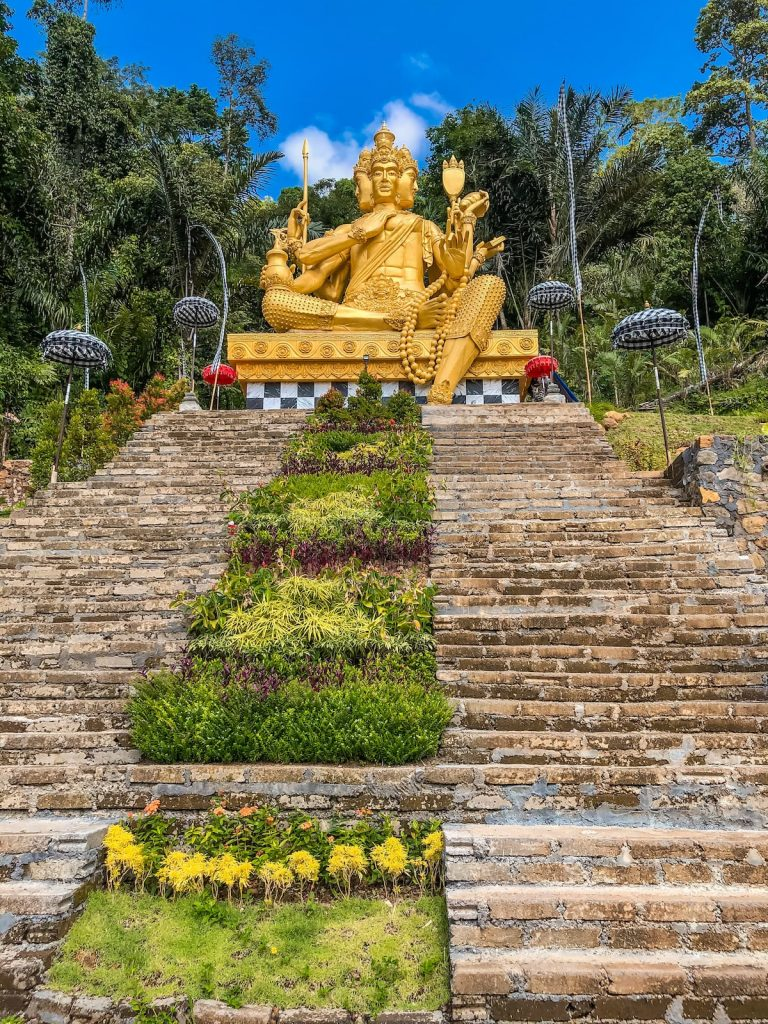 Golden statue at the Jagasastra Waterfall
