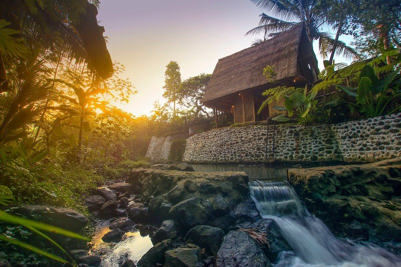 tree house hotels in bali - hideout bali -bamboo house near a river