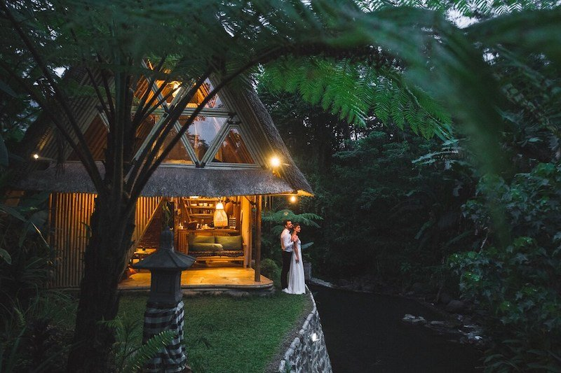 tree house hotels in bali - hideout bali - couple standing in front of a tree house