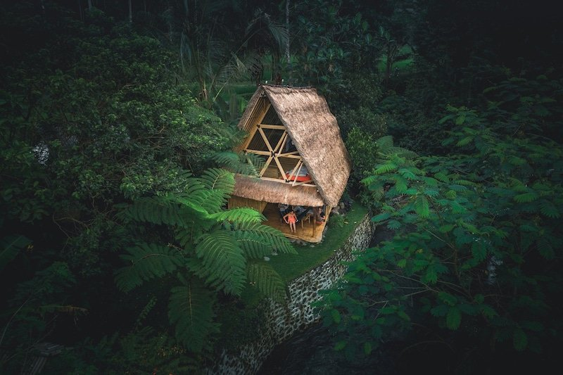 tree house hotels in bali - hideout bali -drone shot of bamboo house