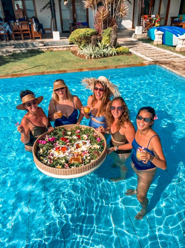 Team Bali Buddies enjoying a floating afternoon delight in the pool
