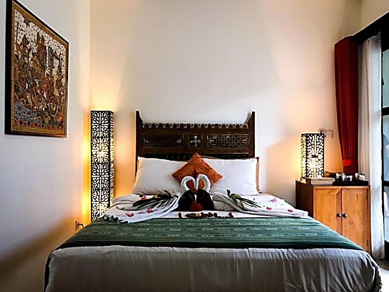 Cuddle with fur babies in one of the charming rooms of Kembali Lagi Guest House
