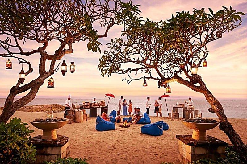 Enjoy outdoor dining by the beach at Conrad Bali Nusa Dua